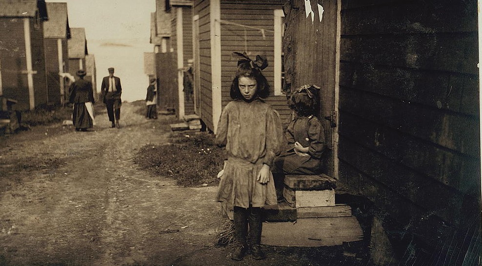 Nan de Gallant, 4 Clark St., Eastport, Maine, 9 year old cartoner, Seacoast Canning Co., Factory #2. Packs some with her mother. Mother and two sisters work in factory. One sister has made $7 in one day. During the rush season, the women begin work at 7 a.m., and at times work until midnight. Brother works on boats. The family comes from Perry, Me., just for the summer months. Work is very irregular. Nan is already a spoiled child. Location: Eastport, Maine. Photo by Lewis Hines August 1911