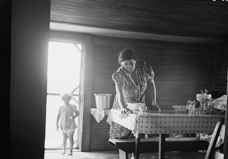 Wife of tobacco sharecropper in kitchen of home. Person County, North Carolina by Dorothea Lange July 1939