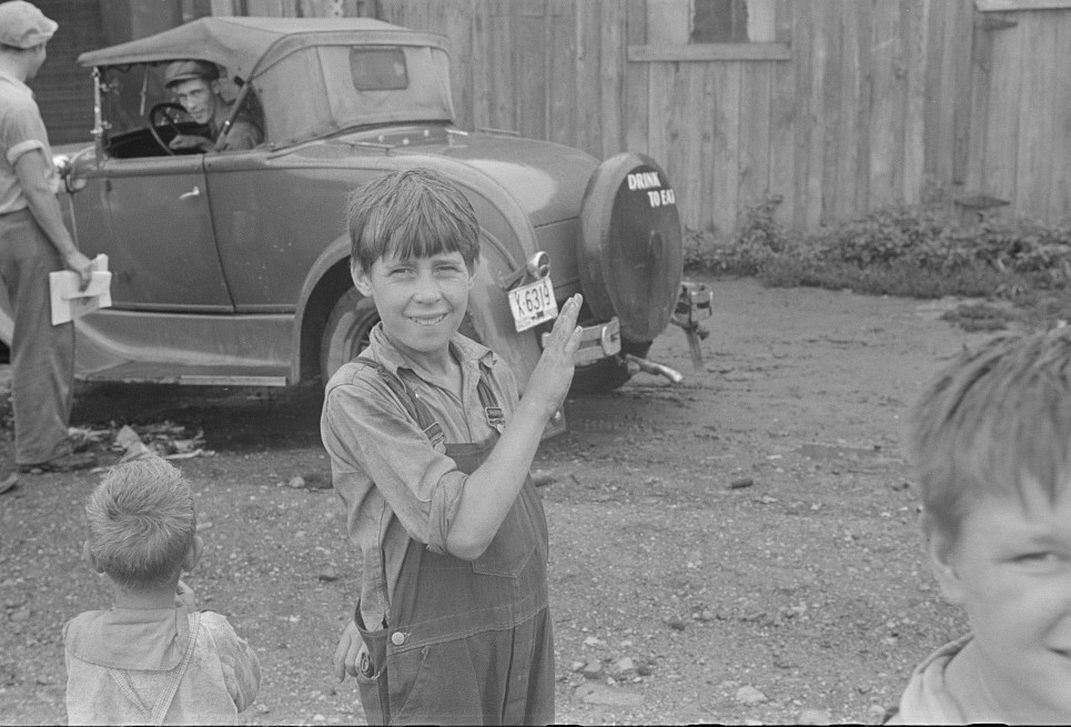 Hooverville children and car