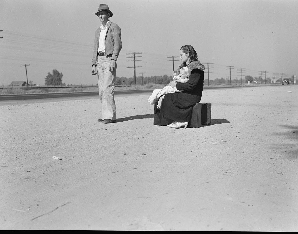 Young family, penniless, hitchhiking on U.S. Highway 99,