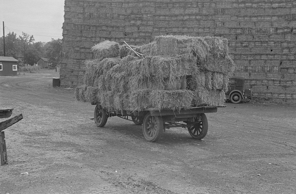 baled straw on wagon