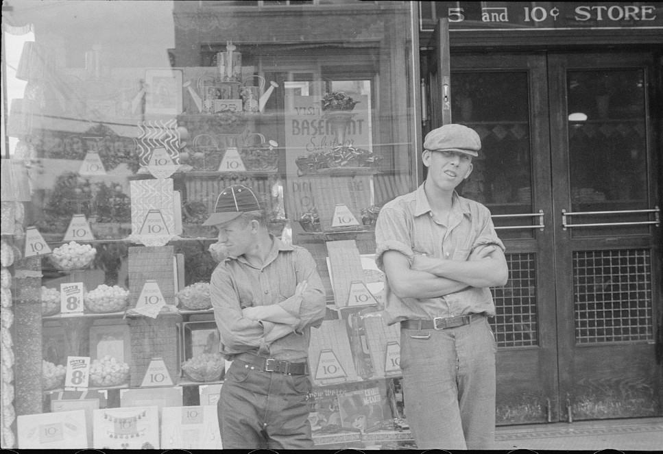 two boys in front of candy store