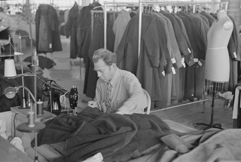Boris Drasin, president of the workers' Aim Association Inc., works as an operator in the garment factory at a the same wage as the other operators. nov. 1936