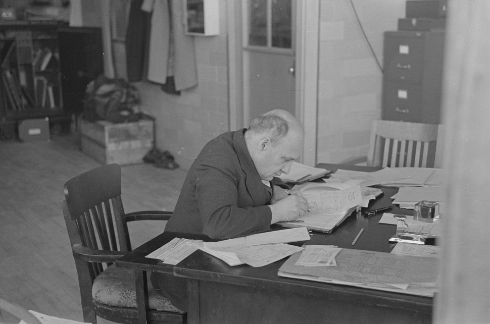 Comptroller of factory at Jersey Homesteads at work in office, Hightstown, New Jersey 1936 russell lee