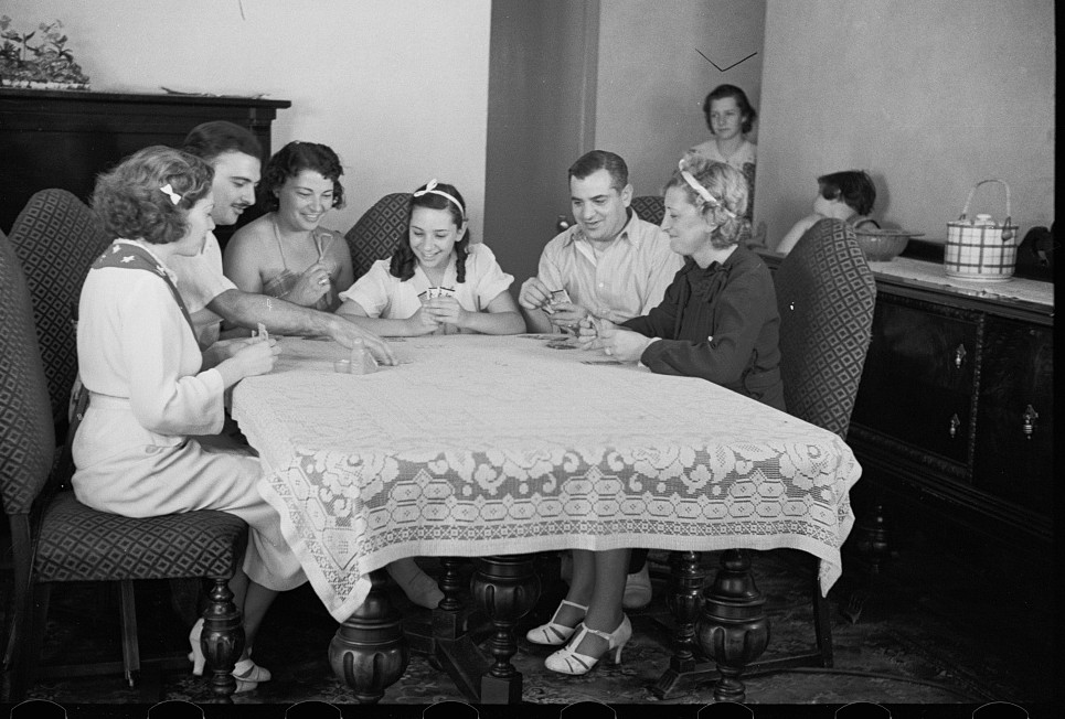 Family group playing cards in one of the new homes on the Hightstown Project, New Jersey 1936 carl mydans