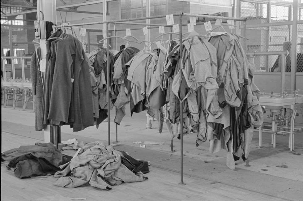 Half-made garments on the racks, awaiting final operations of the machines, in cooperative garment factory, Hightstown, New Jersey nov. 1936 russ