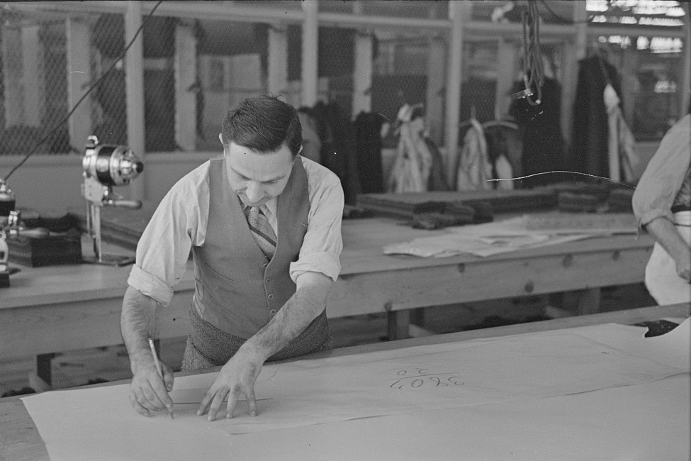 Louis Gushen, chief cutter in the cooperative garment factory at Jersey Homesteads, is cutting the pattern for a woman's coat. Hightstown, New Jersey 1936 russ