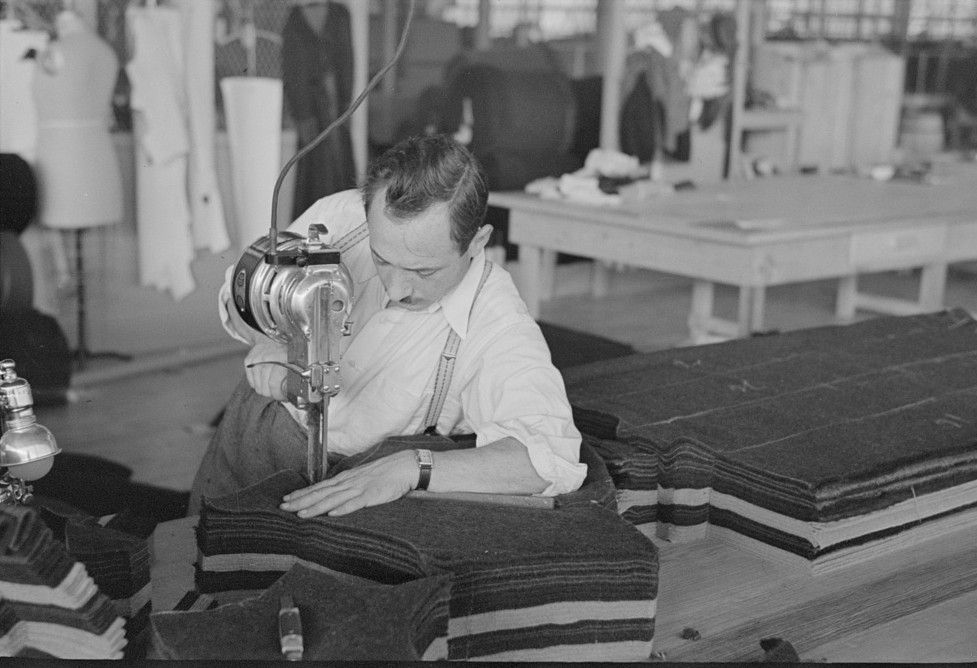 Philip Goldstein assistant cutter in the cooperative garment factory at Jersey Homesteads. He is secretary of the Colonists' Association, Inc., Hightstown, New Jersey 1936 russ
