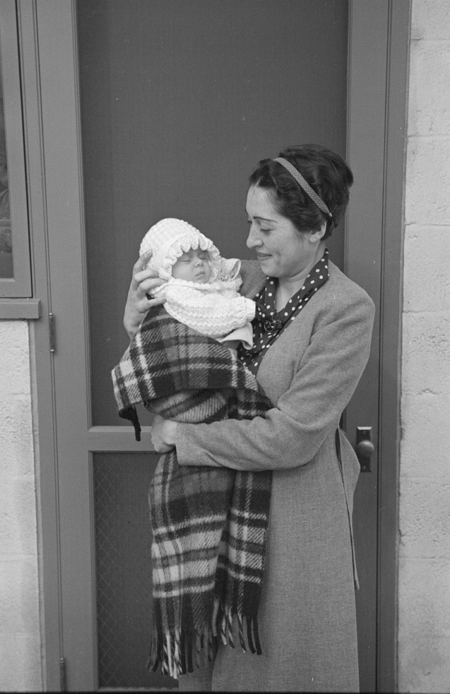 The first baby born, early in October 1936. She is the daughter of Mr. and Mrs. Philip Goldstein, who were moved into the colony July 10, 1936 Nov. 1936 russ