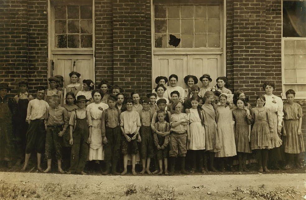 All are workers in Roanoke Cotton Mills Smallest boy in the middle helps