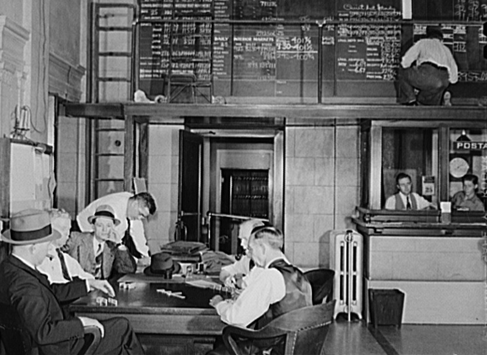 As soon as the market closes members of the cotton exchange very often start a card or domino game. Memphis, Tennessee Marion Post Wolcott Nov. 1939