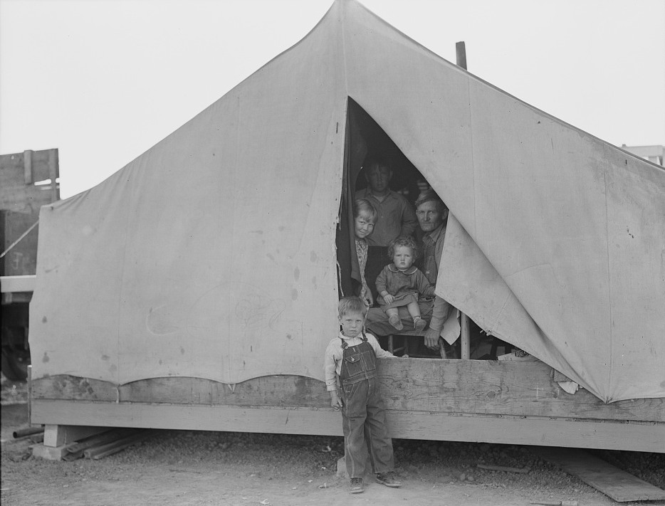 Brawley, Imperial Valley. In Farm Security Administration (FSA) migratory labor camp. Family of mother, father and eleven children