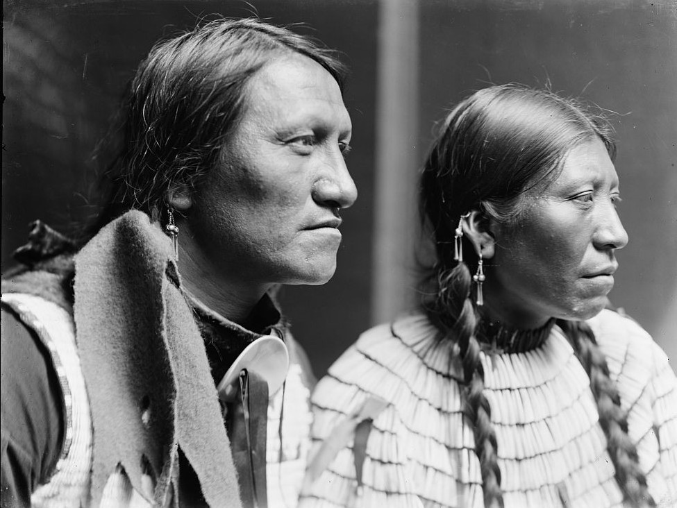 Charging Thunder and dog, probably members of Buffalo Bill's Wild West Show, head-and-shoulders portraits,taken by photographer Gertrude Kasebier (1852-1934) around 1900