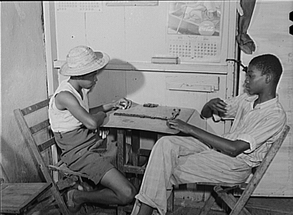 Charlotte Amalie, Saint Thomas Island, Virgin Islands. Playing dominoes in a small candy store Jack Delano Dec. 1941