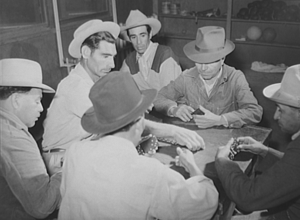 Domino game on Saturday night. Community center. Robstown camp, Texas Arthur Rothstein Jan 1942