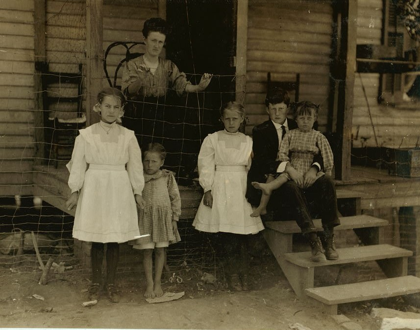 Family of A.P. Stata (he is at church). Father, son and two oldest girls in photo work in Washington Cotton Mills, Fries, Va. The little spinner on left of photo has been working three years.