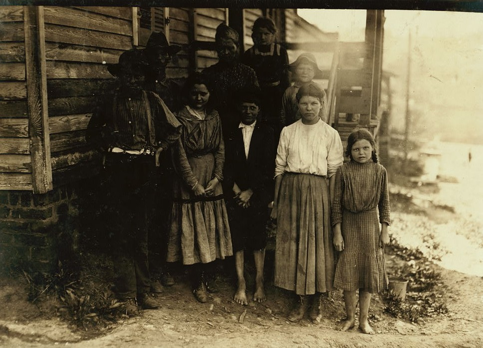 Family of J. J. Moore. All but mother and two smallest children on steps work in Washington Cotton Mills, Fries Va. Smallest spinner right hand end of front row said she was 14, but she surely is not.
