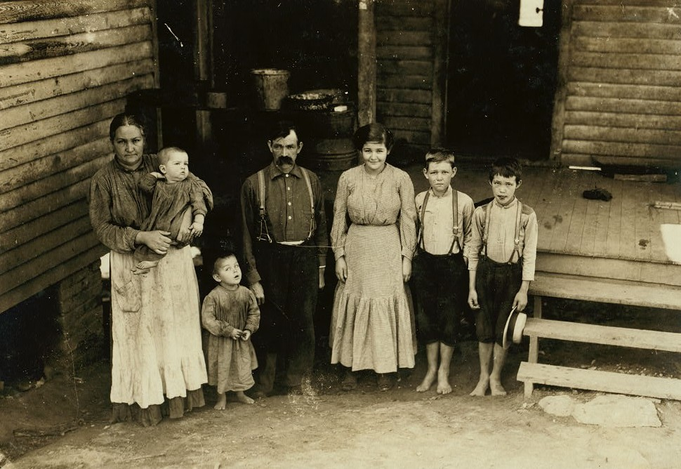 Family of L.W. Money. Father, daughter and two boys work in spinning room of Washington Cotton Mills. Fries, Va. Smallest worker said he was thirteen, but it is doubtful.