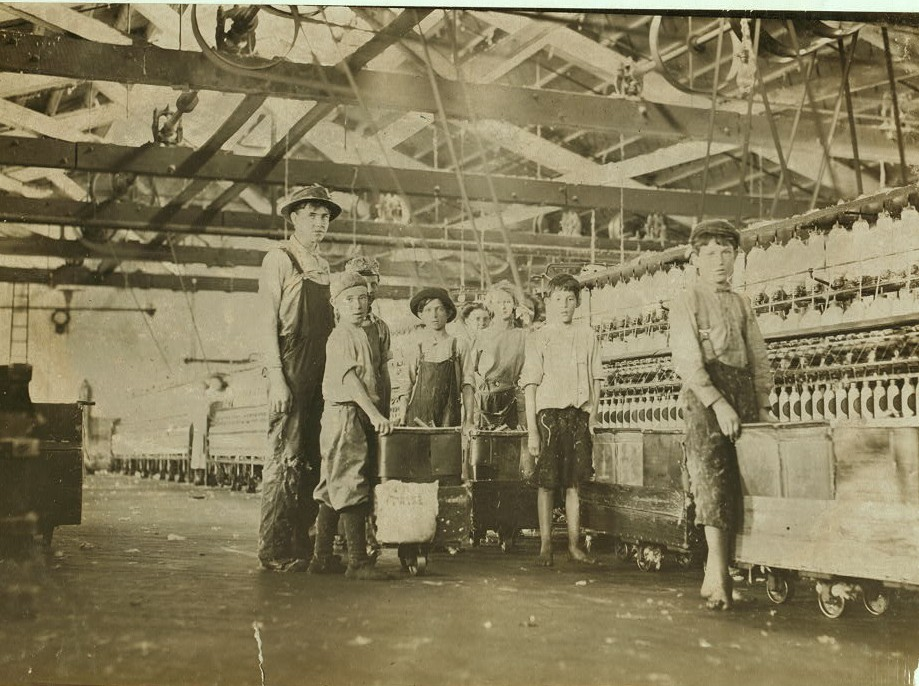 Group of doffers and spinners working in Roanoke Cotton Mills I counted seven apparently under fourteen and three under twelve years old. . May 1911