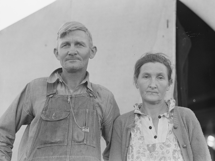 In Farm Security Administration (FSA) migratory labor camp. Family, mother, father and eleven children, originally from Oklahoma, where he had been a tenant farmer. Came to California in 1936