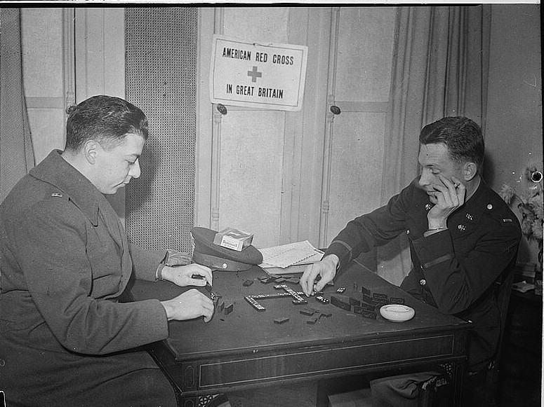 London, England. Lieutenant Samuel Levin, left, of New York City, and Lieutenant Fred O. Wickham, of Jefferson City Missouri, playing a game of dominos