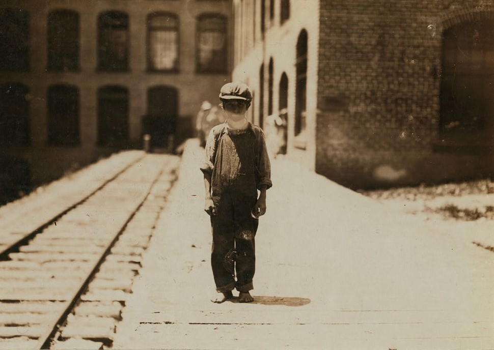 One of the young doffers in Washington Cotton Mills, Fries, Va., going to dinner. Said he was 15 years old, but it is doubtful