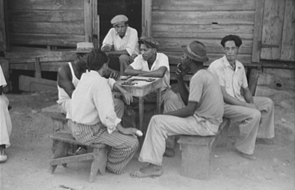 Playing dominoes in the slum area known as El Machuelitto in Ponce, Puerto Rico - Delano Dec. 1941