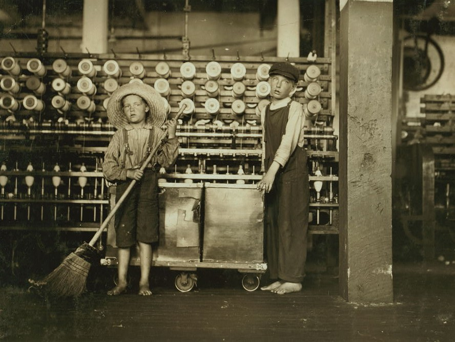Ronald Webb, twelve year old doffer boy and Frank Robinson, seven year old who helps sweep and doff. Father is cardroom boss, Roanoke Va. Cotton Mills. Location Roanoke, Virginia. May 1911