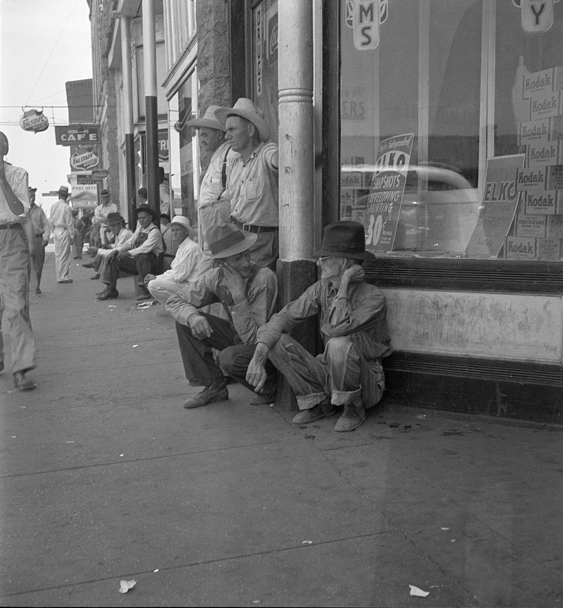 Sallisaw, Sequoyah County, Oklahoma. Oklahoma drought farmers. Nothing to do. These fellers,said one of them, are goin to stay right here till they dry up and die too Aug. 1936