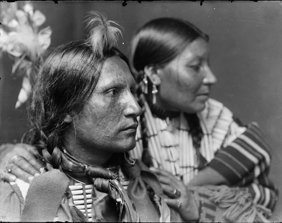 Samuel American Horse and wife, probably members of Buffalo Bill's Wild West Show, head-and-shoulders portrait, facing right. gertrude