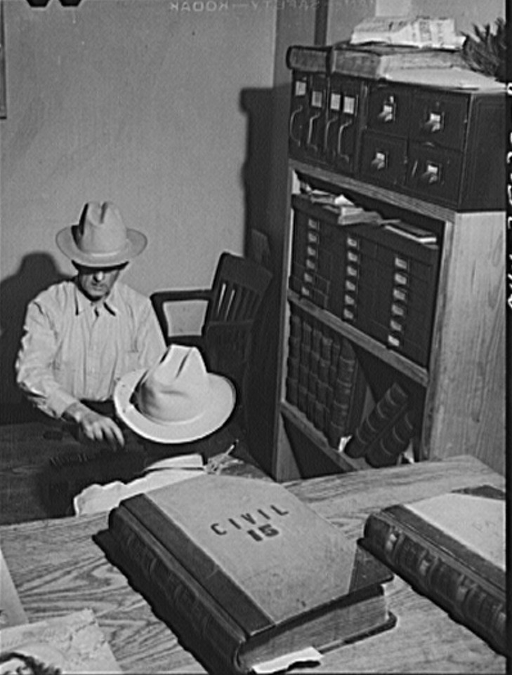 San Augustine, Texas. Justice of the Peace, R.L. Armstrong and night marshall Jeff Davis playing dominoes in a courthouse office John Vachon April 1943