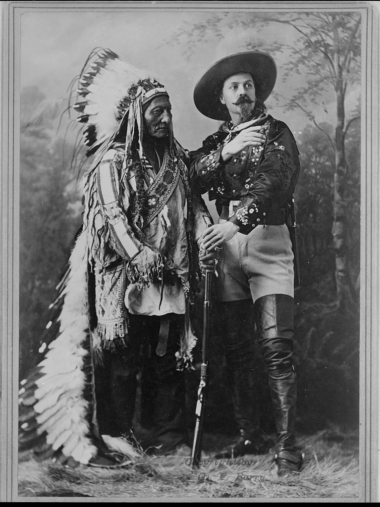 Sitting Bull and Buffalo Bill, 1885 by fence