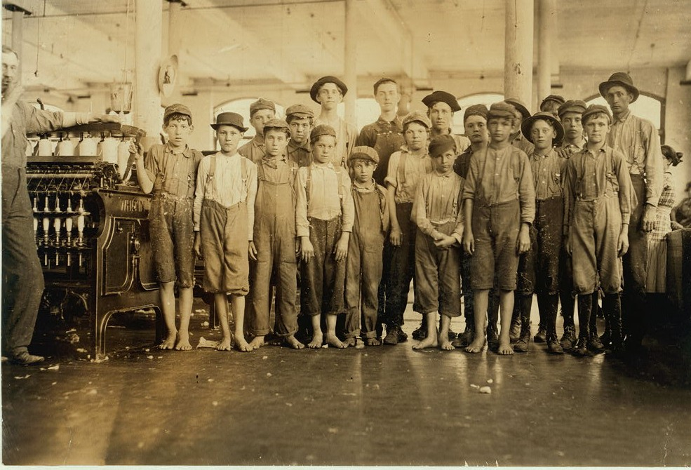 Some of the doffers in the Washington Cotton Mills, Fries, Va. The smallest one said he was 15 years old but, for that matter, they are all wise to the necessity for being at least 14. All work.