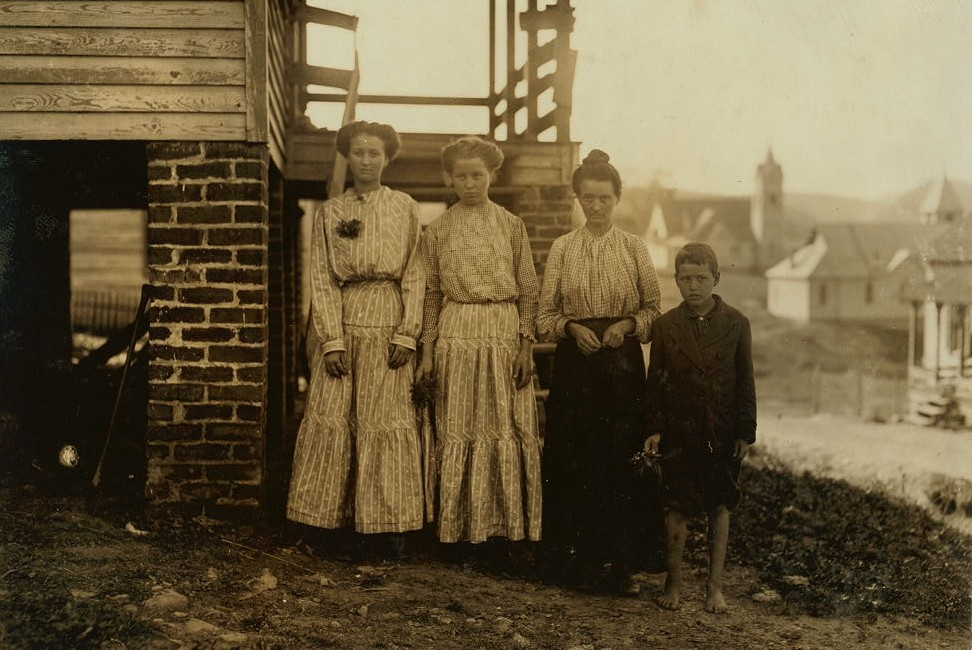 Tommy Bullard and his family. He has been sweeping for over a year in Washington Cotton Mills, Fries, Va. Said he was 13, but it is doubtful. Mother is a widow. Sisters in the mill too. Family came a year ago