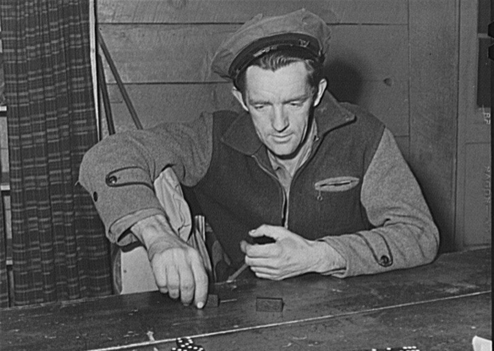 Tulare County, California. FSA (Farm Security Administration) farm workers' camp. Domino game  Feb. 1942 Russell Lee
