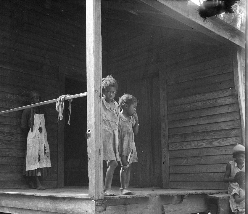 2Children of turpentine worker near Cordele, Alabama. The father earns one dollar a day July 1936 Dorothea Lange