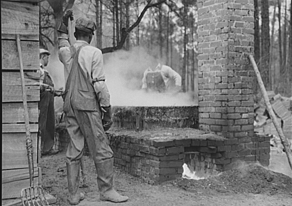 2Cleaning turpentine cups in boiling water at a still near Pembroke, Georgia 1941 by Jack Delano