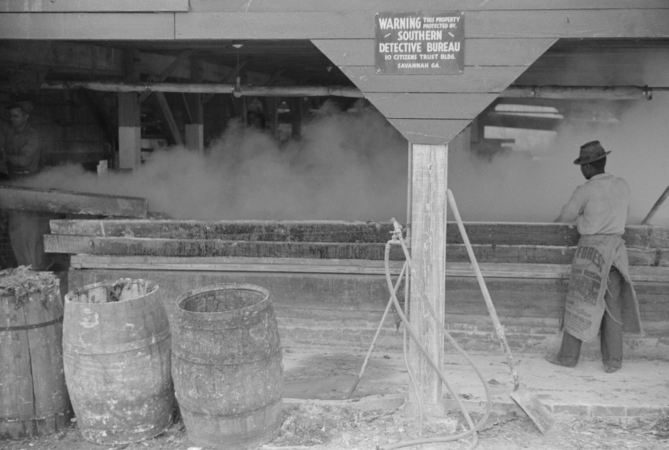 2Filtering hot rosin through sieves at a turpentine works in Statesboro, Georgia Apr. 1941 Jack Delano