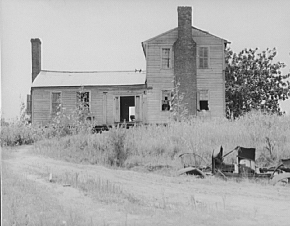 A plantation house decaying and now vacant but for two rooms occupied by an old couple, Negro tenants. Greene County, Georgia 1937 dorothea lange