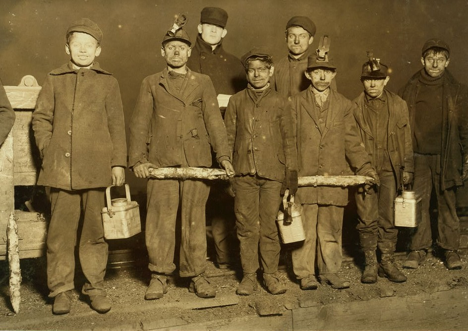 At the close of the day. Just up from the shaft. All work below ground in aPennsylvania Coal Mine. Smallest boy, next to right hand end is a nipper.