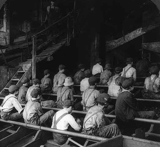 Boys picking slate in a great coal breaker, anthracite mines, Pa. 1913 Photographer Underwood & Underwood