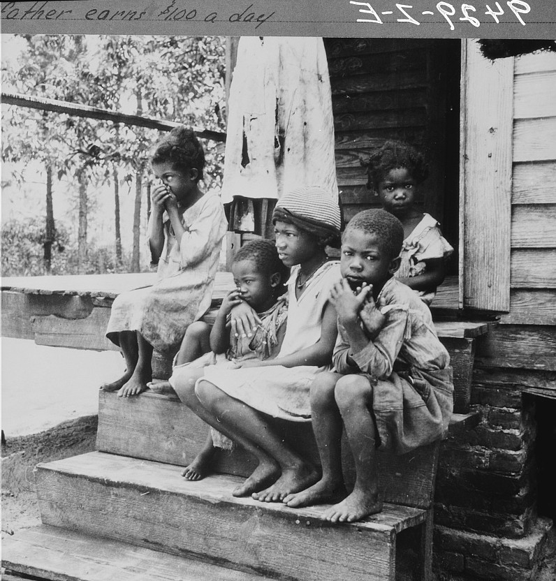 Children of turpentine worker near Cordele, Alabama. The father earns one dollar a day July 1936 Dorothea Lange