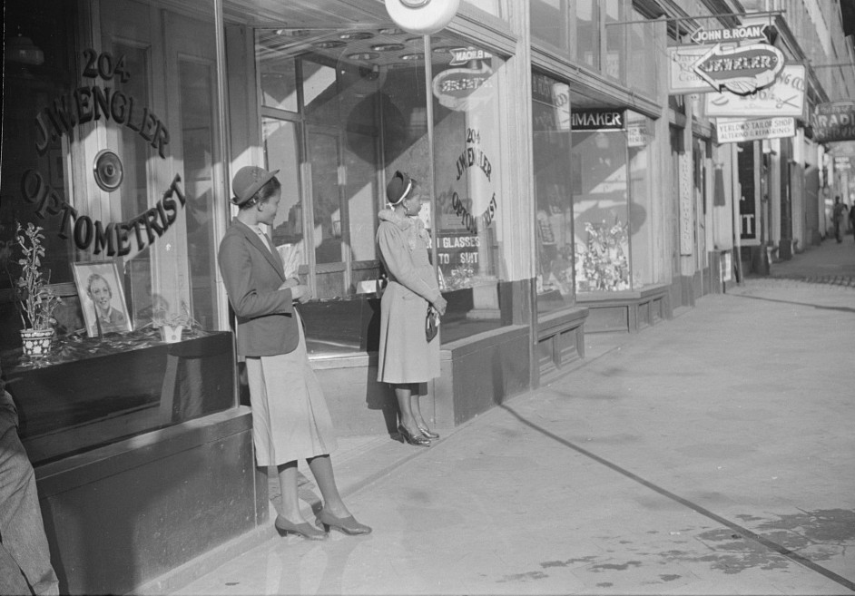 Domestic servants waiting for streetcar on way to work early in the morning. Mitchell Street, Atlanta, Georgia