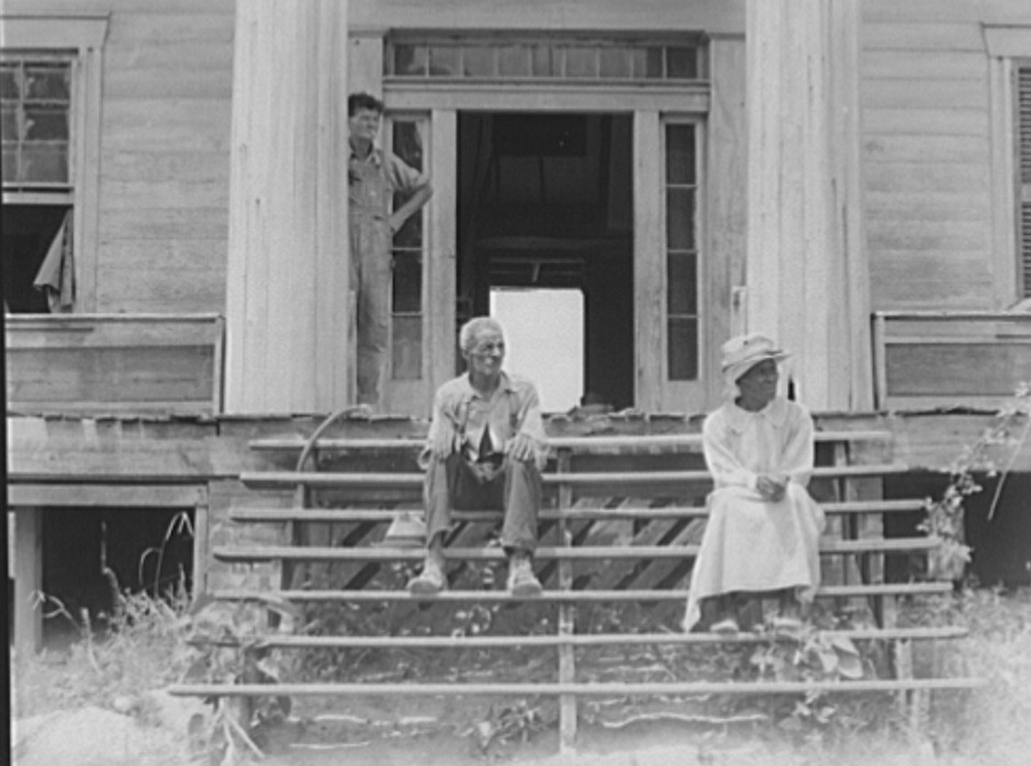 Ex-slave and wife on steps of plantation house now in decay. Greene County, Georgia 1937 dorothea lange