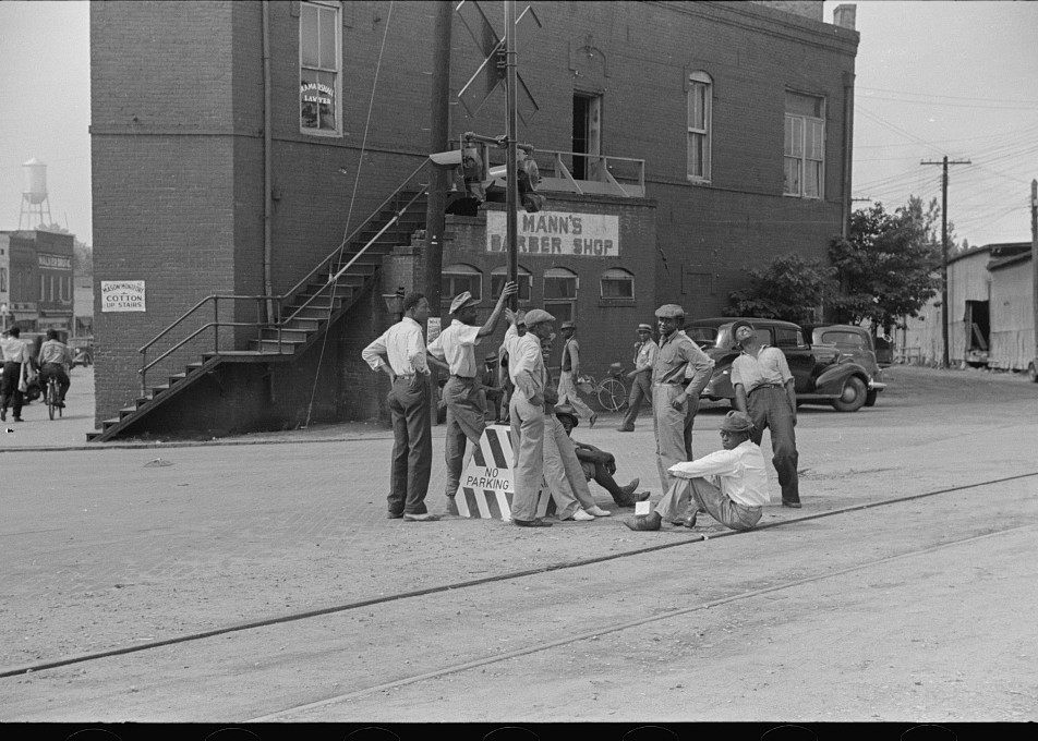 Hanging around railroad tracks in center of town of Fitzgerald, Georgia 1939