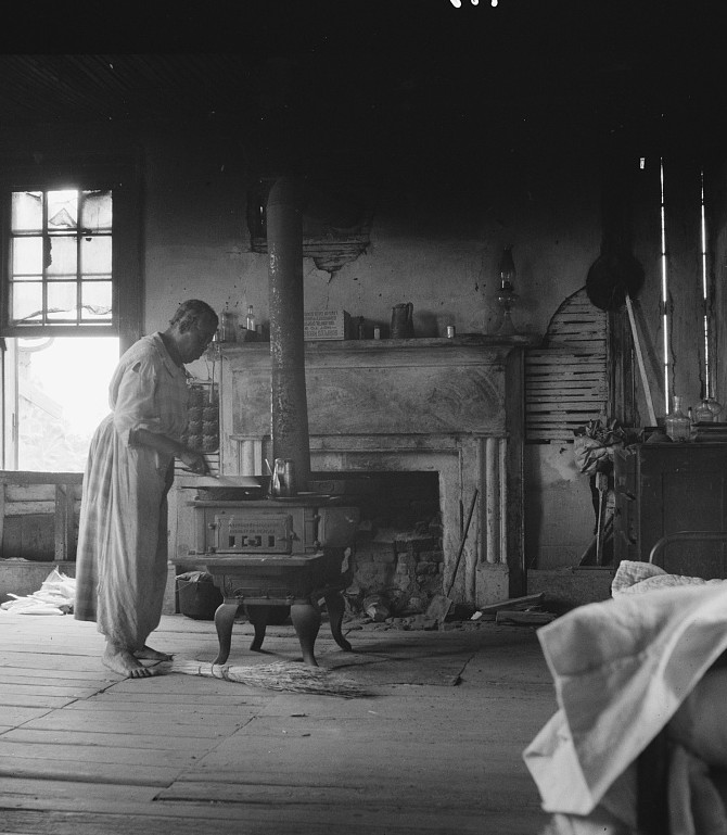 Interior of a plantation house now vacant but for two rooms occupied by an old Negro couple, tenants. Greene County, Georgia2 1937 dorothea lange