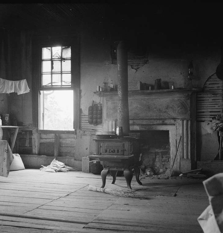 Interior of plantation house now vacant but for two rooms occupied by an old Negro couple. Negro tenants, Greene County, Georgia 1937 dorothea lange