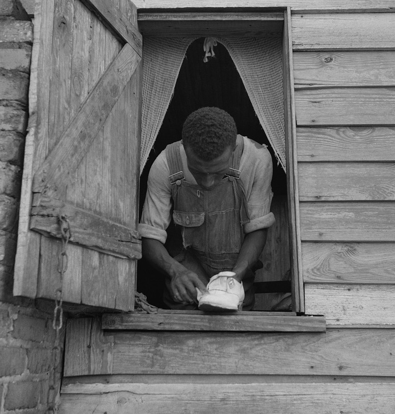 Negro field hand getting ready to go to town on a Saturday afternoon. His wages seventy-five cents a day and cabin. He has six children
