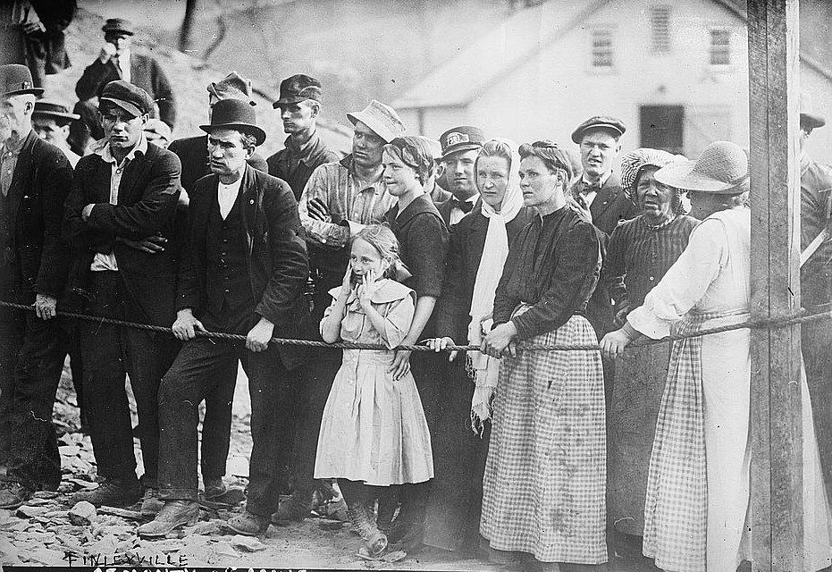 Photo shows people at the Cincinnati coal mine, located near Finleyville, Pennsylvania, where a fire and explosion resulted in the deaths of 97 miners on April 23, 1913.