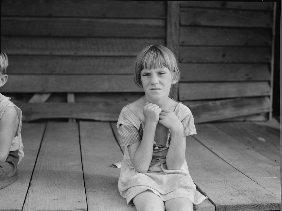 Sharecropper's child whose father receives five dollars a month furnish from the landowners. Macon County, Georgia 1937 lange